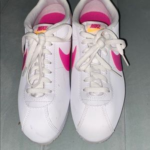 Pink and yellow nike shoes